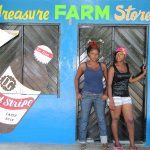 "The Jamaican vision of beauty keeps evolving. ""Most of the young girls now coming up ? they don't want fat no more, they want slim and trim,"" says farmer Kadesha Abrahms (left) at a feed store in Treasure Beach, Jamaica. (Image: Davia Nelson for NPR)"