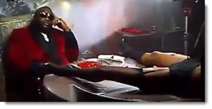 Rick Ross sits in view of a dead/drugged woman & a plate of raw meat