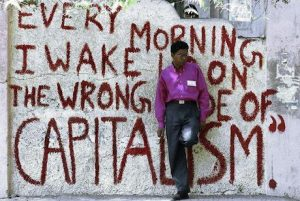 Every morning I wake up on the wrong side of capitalism. Credit: Street Art Utopia, Sun Rise Above.