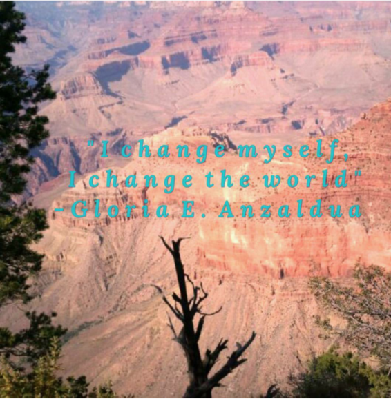 saying in blue with mountains in background.