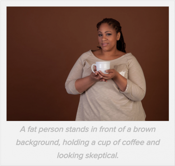 a fat woman holds a cup of coffee